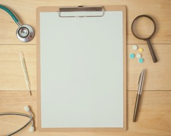 medical equipment and white paper on a clipboard for medical concept background