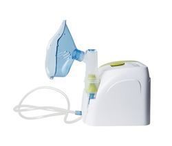 Medical equipment for inhalation with respiratory mask. Nebulizer isolated on white background with clipping path. Asthma breathing treatment. Bronchitis, asthmatic health equipment