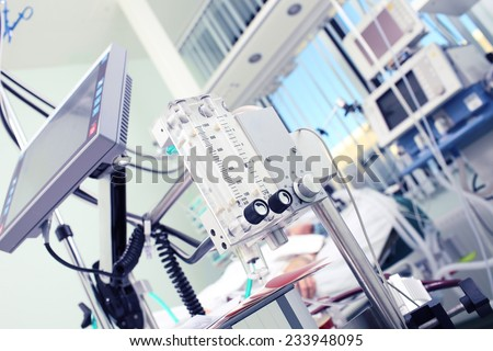 Medical equipment in the foreground of the patient's room