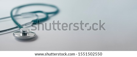 Medical examination and healthcare service concept . stethoscopes green silver stethoscope. Healthcare.