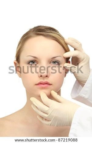 Medical examination of beautiful woman face - close-up portrait isolated on white