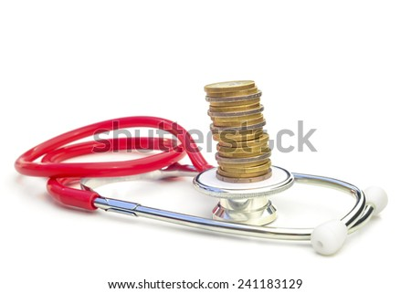 Medical expenses 4.  --  A stethoscope with a pile of coins on top.