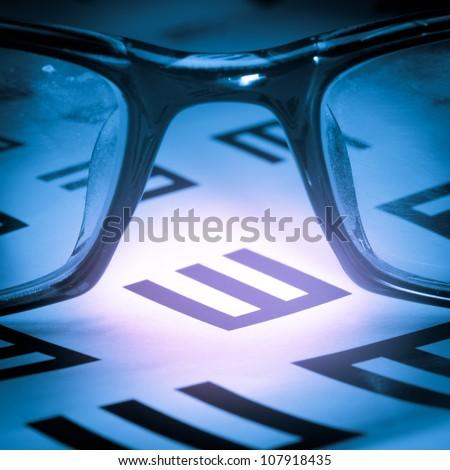 medical eye chart and glasses