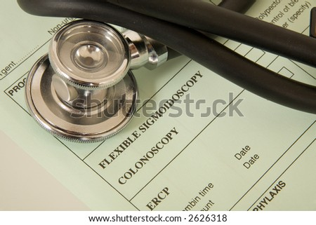 Medical forms and stethoscope.