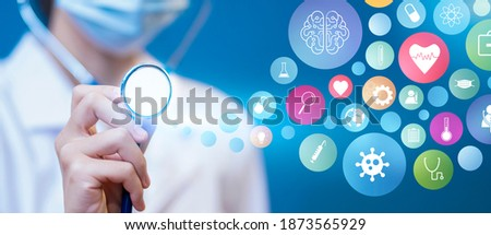 Medical healthcare Asian female doctor using stethoscope technology futuristic holographic wearing surgical protective face mask, information diagnosing patient health, blue isolated background Foto stock ©