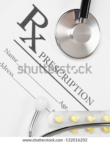 Medical ideas - blank prescription with pills and stethoscope above it