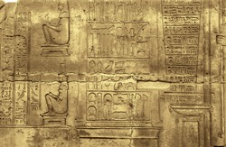 Medical instruments image at the Temple of Kom Ombo, showing also prescriptions and two goddesses sitting on birthing chairs. Egypt