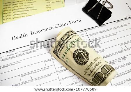 Medical insurance claim form, bills and cash