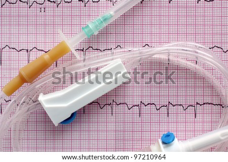 medical intravenous system on surface of electrocardiogram