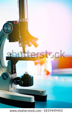 medical laboratory, scientist hands using microscope for chemistry biology test samples,examining liquid, equipment,Scientific and healthcare research  Foto stock ©