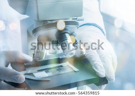 medical laboratory, scientist hands using microscope for chemistry ,biology test samples,examining liquid,Doctor equipment,Scientific and healthcare research background.vintage color