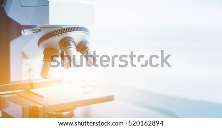 medical laboratory, scientist hands using microscope for chemistry test samples,examining samples and liquid,Medical equipment. microscope,Scientific and healthcare research background.vintage color