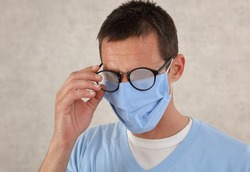 Medical mask and Glasses fogging. Coronavirus prevention, Protection. Doctor portrait close up