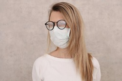 Medical mask and Glasses fogging. Coronavirus prevention, Protection. New habits during Self-isolation , Quarantine