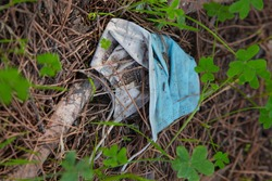 medical mask on the floor in the woods