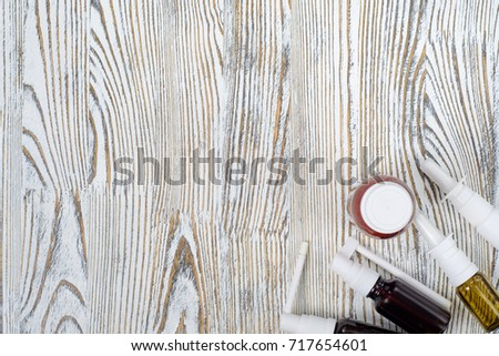 Medical medications tablet medications on a white wooden surface #717654601