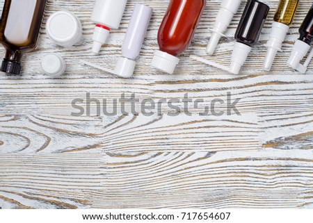 Medical medications tablet medications on a white wooden surface #717654607