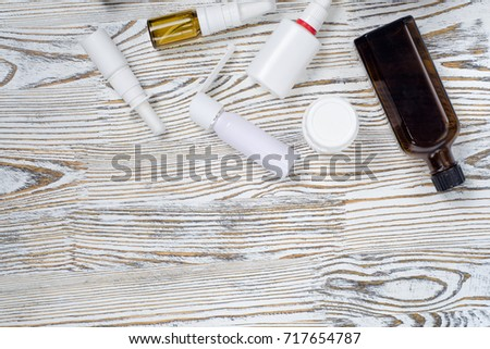 Medical medications tablet medications on a white wooden surface #717654787