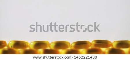 Medical medicines and supplements transparent capsules of yellow color #1452221438