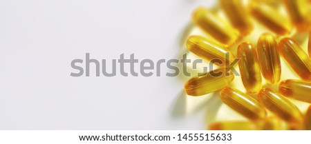 Medical medicines and supplements transparent capsules of yellow color #1455515633