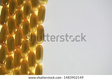 Medical medicines and supplements transparent capsules of yellow color #1483902149