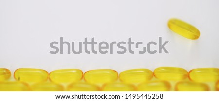Medical medicines and supplements transparent capsules of yellow color #1495445258