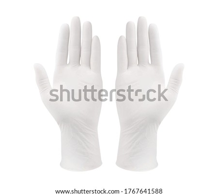 Medical nitrile gloves.Two white surgical gloves isolated on white background with hands. Rubber glove manufacturing, human hand is wearing a latex glove. Protective latex gloves