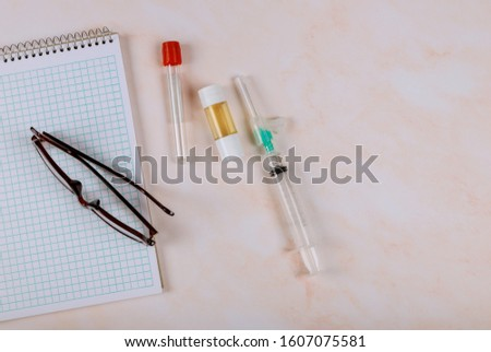 Medical office professionals at glasses over notebook health care professional occupation