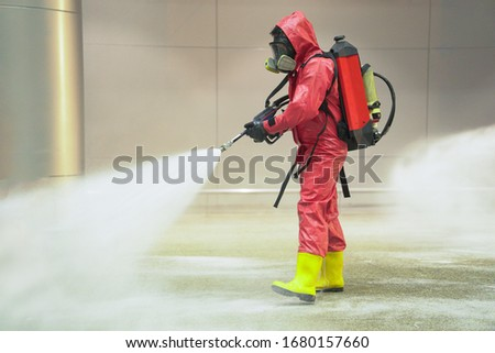 medical officers prepare chemical protection suit and working in airport area to cleaning virus with anti bacteria chemical