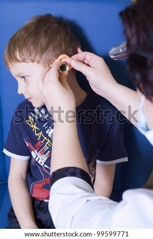 Medical otitis examination of a child at a ear nose throat doctor