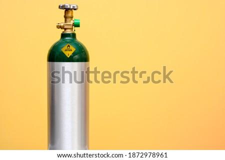 Medical Oxygen Tank Isolated on Yellow Background Stock photo ©