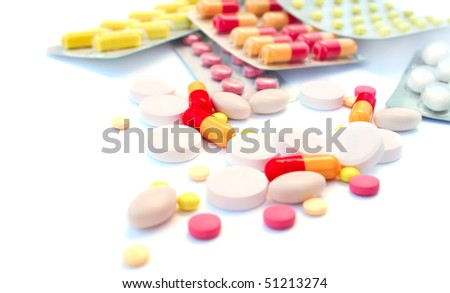 Medical pills and tablets isolated on white background.
