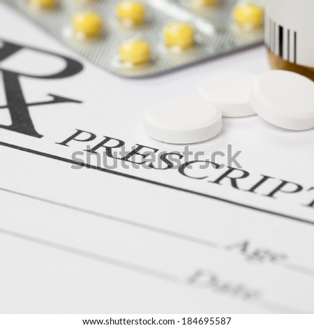Medical prescription and several pills on table - 1 to 1 ratio