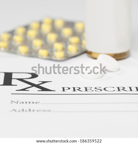 Medical prescription with pills on table - 1 to 1 ratio