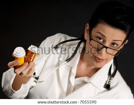 Medical professional in white coat showing pill bottles