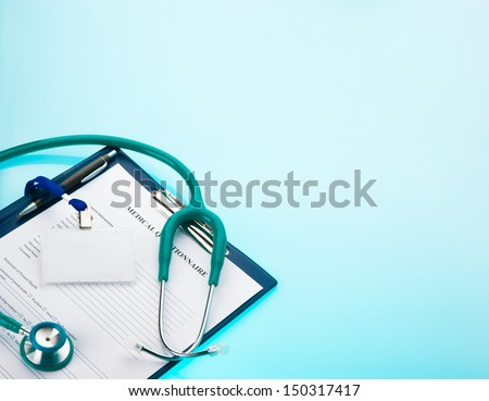 Medical questionnaire, stethoscope and empty ID tag on blue background
