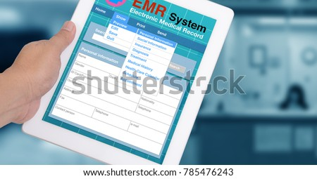 Medical record system show on tablet in someone hand with blue background.