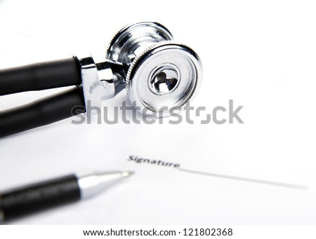 medical records, stethoscope and writing pen on the white table