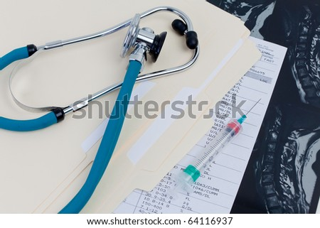 Medical Records, Stethoscope, syringe, MRI exam, blood test results folder
