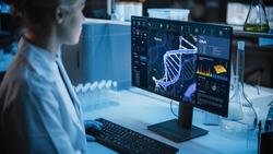 Medical Research Laboratory: Portrait of Female Scientist Working on Computer, Analysing DNA, Virus. Advanced Scientific Lab for Medicine, Biotechnology, Vaccine Development. Dark Blue Shot