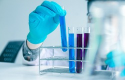 Medical science or male in laboratory room researcher performs tests with blue liquid on test tube , Experimental Drug Treatment Chemicals