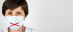 Medical secrecy and nondisclosure of diagnosis concept. Woman doctor in mask with taped lips, white uniform on white background. Medical secrecy concept