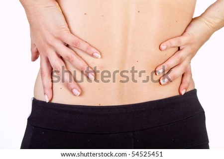 Medical shot showing a woman with pain in her back. Isolated over white.