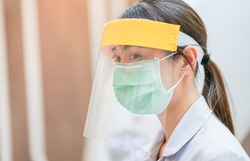 Medical staff wearing face shield and medical mask for protect coronavirus covid-19 virus in CT scan room, protective Epidemic virus outbreak concept