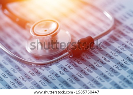 Medical stethoscope on a medical Record or chart.