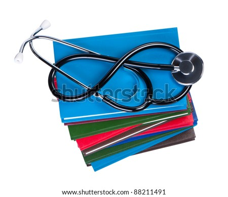 Medical stethoscope on pile books isolated. - stock photo