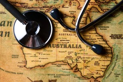 Medical stethoscope over Australia healthcheck. Medical concept tourism travel care diseases healthy, close-up. Australian health care with map and stethoscope