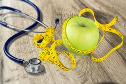 Medical stethoscope with apple, healthy food,