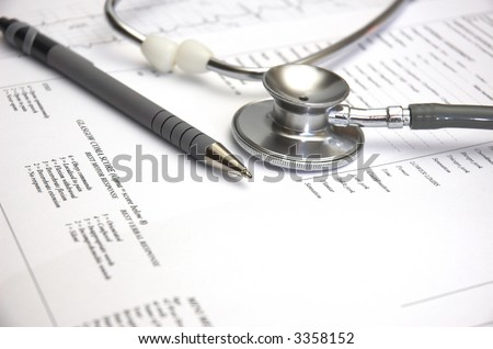 Medical still life with Hospital admission paperwork and a Doctor's stethoscope.