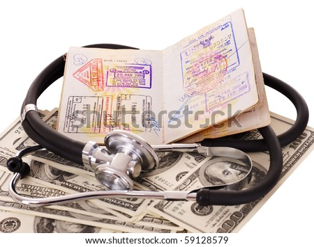 Medical still life with stethoscope, money and passport. Isolated.